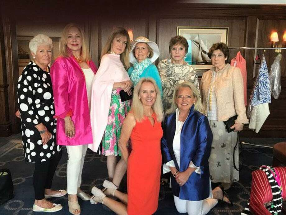Members of the Women's Club of Greenwich at the Annual Luncheon and Fashion Show strike a pose with Nancy Wasche (pictured bottom right), owner of PINKY of Greenwich. Photo: Contributed