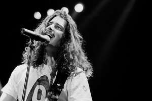 Chris Cornell performing on stage circa 1990.