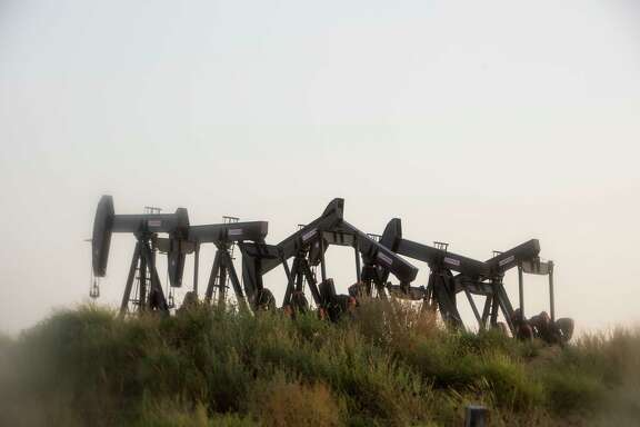 Six pumpjacks stand outside of Cotulla, Texas in the Eagle Ford Shale region.