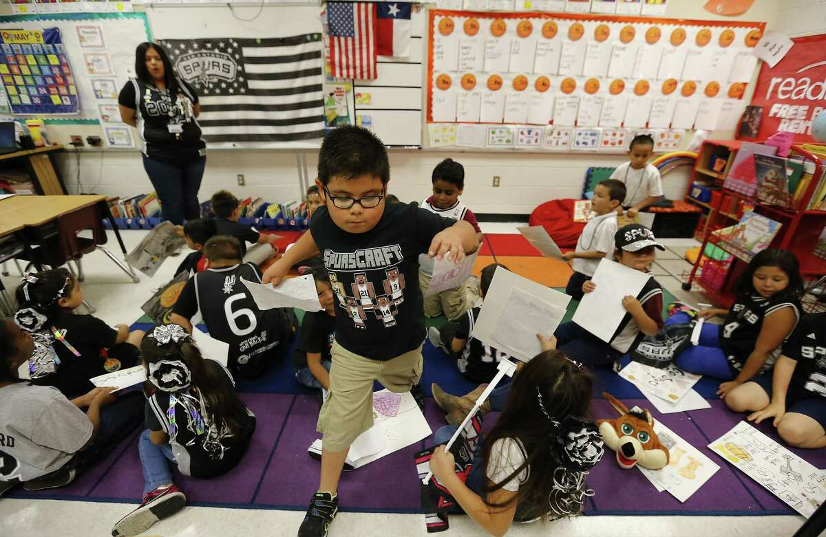 Roy Cisneros Elementary first grade students in Ms. Jessica Vidaurri's class root for the San Antonio Spurs on Friday, May 19, 2017. Vidaurri - a season ticket holder - has decorated her classroom with Spurs posters, a flag and even a