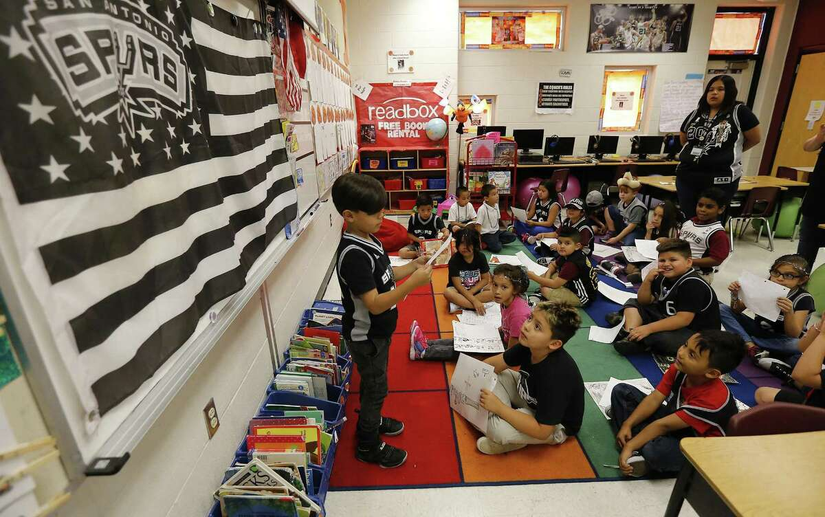 Roy Cisneros Elementary first grade student Aiden Dominguez reads an essay about the Spurs as Ms. Jessica Vidaurri's class roots for the team on Friday, May 19, 2017. Vidaurri - a season ticket holder - has decorated her classroom with Spurs posters, a flag and even a