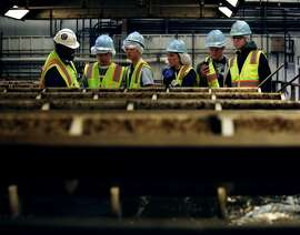 Tour guide and Material Testing Aid Jonathan Smith shows visitors on the tour the gravity belt thicker in the San Francisco Southeast Treatment sewage plant in San Francisco, Calif., Saturday April 25, 2015.