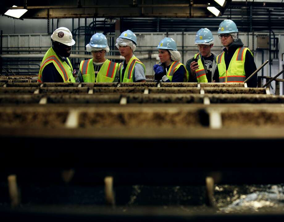 Visitors tour the Bayview sewage treatment plant in San Francisco in 2015. The San Francisco Public Utilities Commission has awarded a nearly $1 billion contract for a sludge processor at the plant. Photo: Sophia Germer, The Chronicle