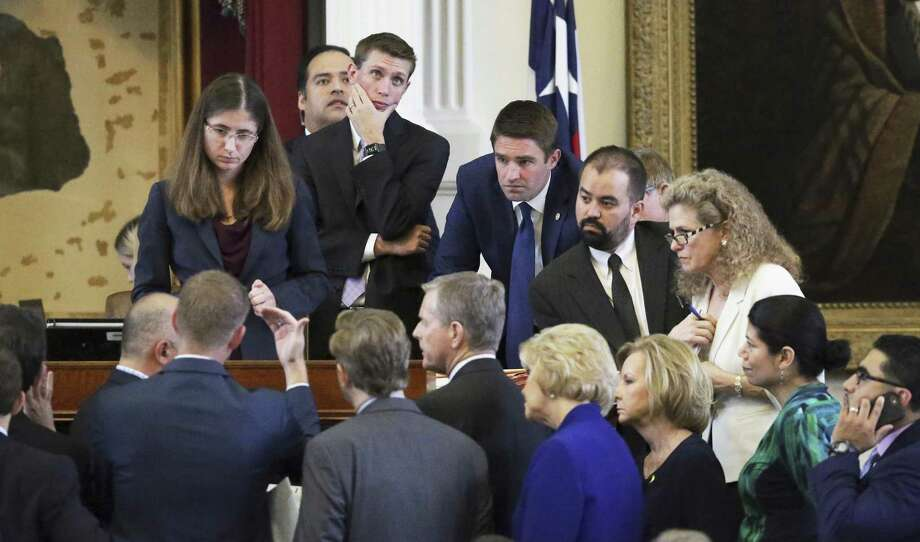A point of order brings representatives to the dais as lawmakers in the House of Representatives debate points about fetal remains Friday at the Texas Capitol. The House tentatively passed Senate Bill 8 after more than five hours of often emotional and testy debate. Photo: Tom Reel /San Antonio Express-News / 2017 SAN ANTONIO EXPRESS-NEWS