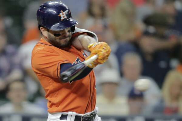 Houston Astros second baseman Jose Altuve (27) connects for a single in the first inning against the Cleveland Indians. Houston Astros and Cleveland Indians play in the first of a four-game series on Friday, May 19, 2017, in Houston. ( Elizabeth Conley / Houston Chronicle )