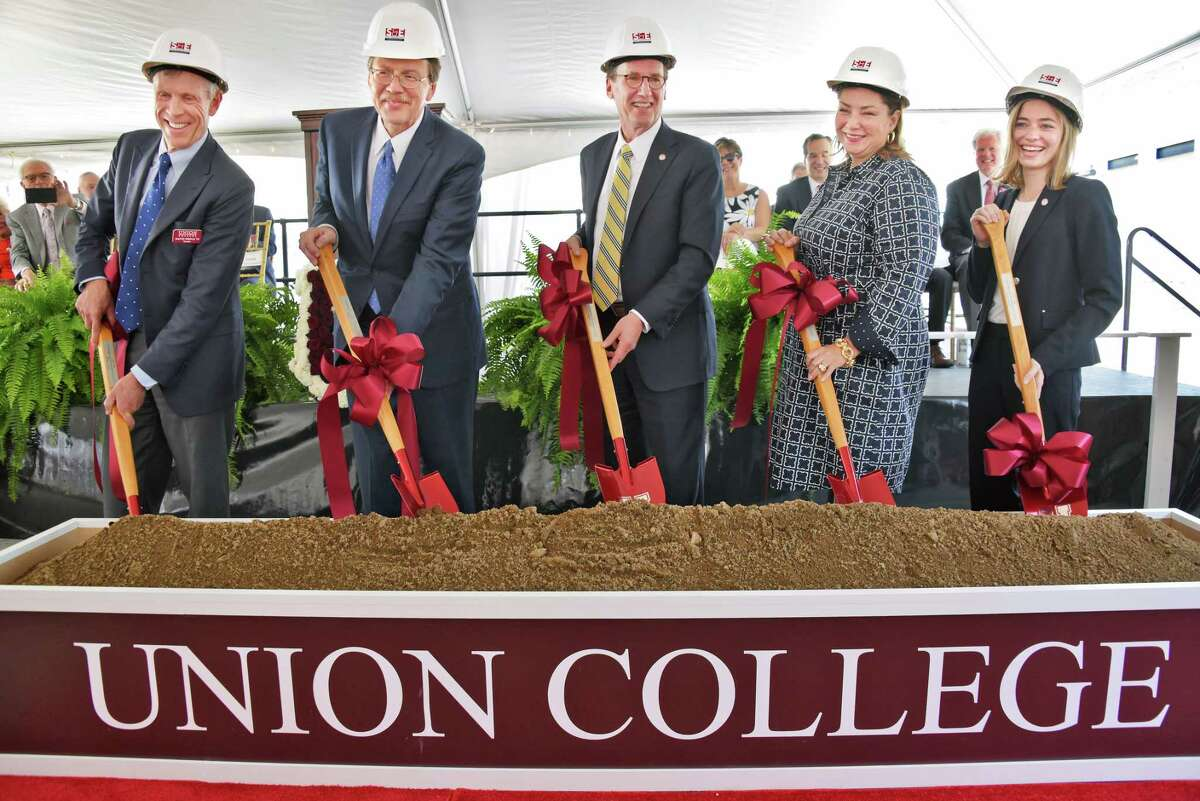 Dignitaries, from left, trustee David Hunle, board president John E. Kelly III, Union College president Stephen Ainlay, Trustee Kelly Williams and Union senior Audrey Hunt break ground for the colege's $100 million Integrated Science and Engineering Complex, the largest and most ambitious project in the schoolOs history, Friday May 19, 2017 in Schenectady, NY. (John Carl D'Annibale / Times Union)
