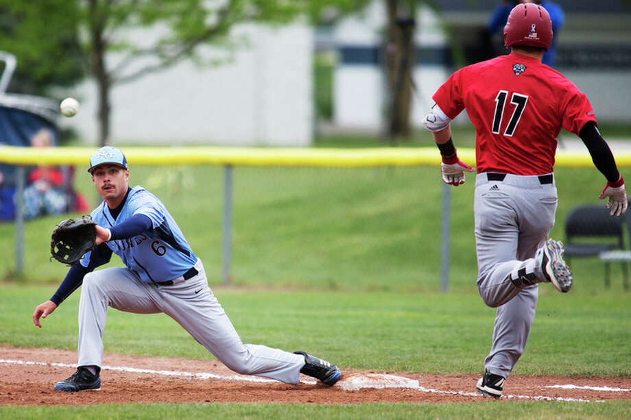 THEOPHIL SYSLO | For the Daily News Northwood University's Robert Spencer extends to make the catch against Drury's Ryan Colombo for an out in a game at Northwood on Friday.