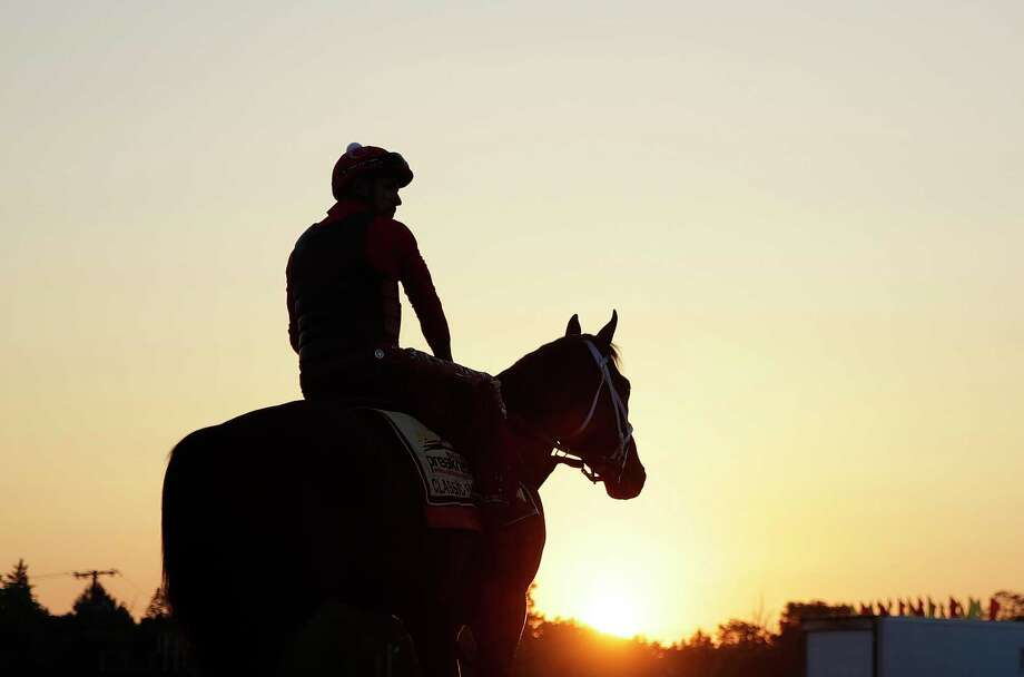 Preakness Stakes contender Classic Empire walks onto the track as the sun rises at Pimlico Race Course in Baltimore, Friday, May 19, 2017. The Preakness Stakes horse race is scheduled to take place Saturday. (AP Photo/Patrick Semansky) ORG XMIT: MDPS103 Photo: Patrick Semansk / Copyright 2017 The Associated Press. All rights reserved.
