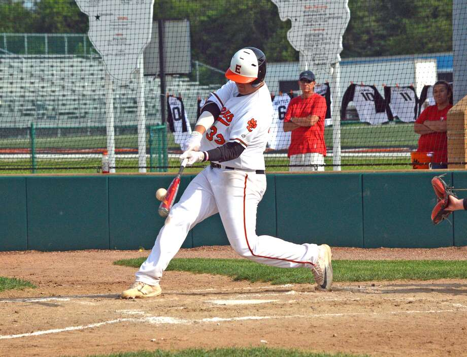 Edwardsville freshman Drake Westcott connects with a pitch for a two-run double in the third inning on Friday in the first game of a doubleheader against Triad at Tom Pile Field.