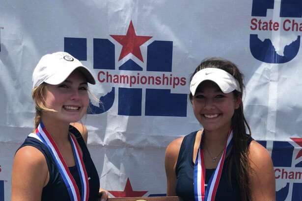 Alamo Heights' Fiona Crawley (left) and Brittney Wilbur pose after winning the UIL Class 5A state girls tennis doubles title on May 19, 2017, at Texas A&M's Mitchell Tennis Center in College Station.