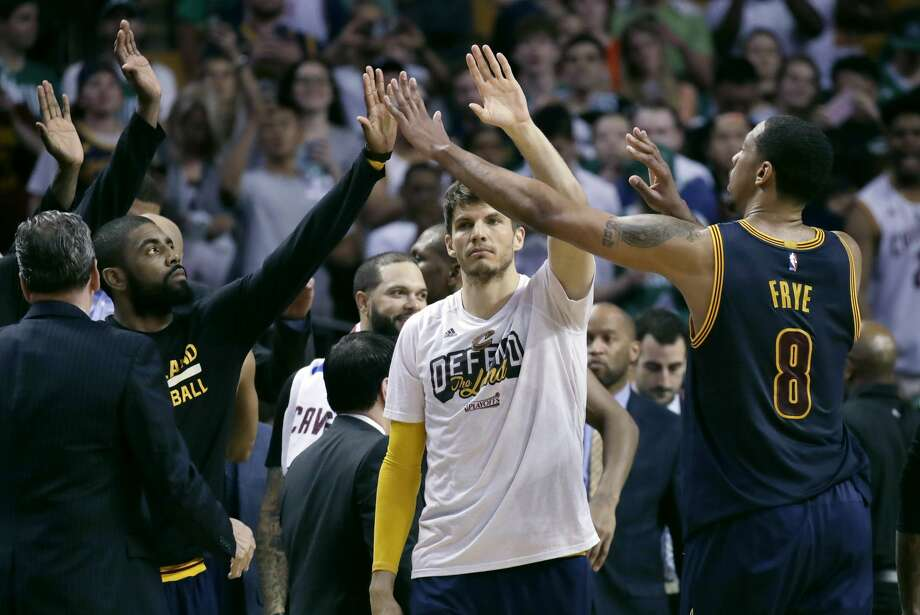 Cleveland Cavaliers' Kyrie Irving, left, Kyle Korver, center, and Channing Frye trade high-fives during the second half of Game 2 of the NBA basketball Eastern Conference finals against the Boston Celtics, Friday, May 19, 2017, in Boston. (AP Photo/Elise Amendola) Photo: Elise Amendola/Associated Press
