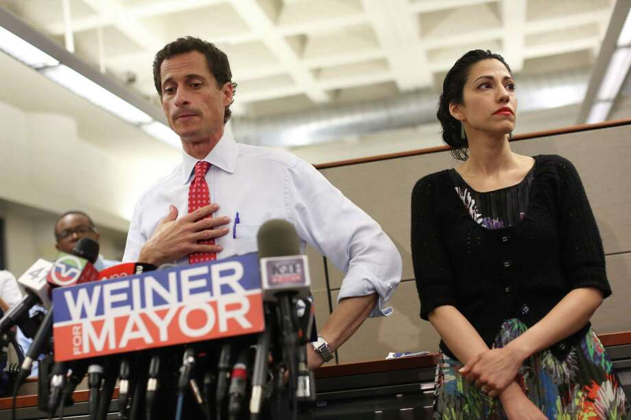 FILE-- Then New York City Mayoral candidate Anthony Weiner, with his wife Huma Abedin, during a news conference  where he addressed revelations that he continued sending raunchy images of himself in online chats after his resignation from Congress in 2011, at the offices of Gay MenOs Health Crisis in New York, July 23, 2013. Photo: MICHAEL APPLETON / NYTNS