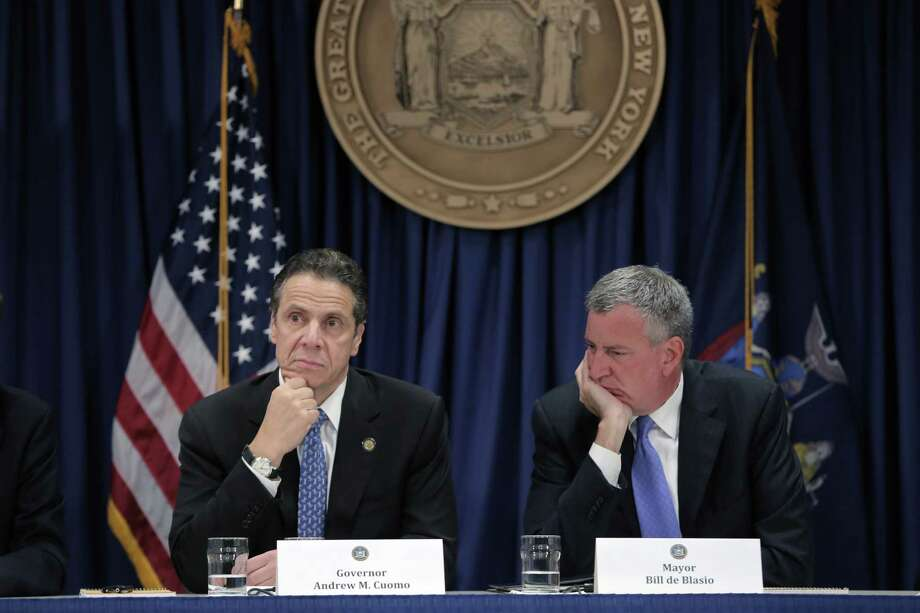 FILE -- N.Y. Gov. Andrew Cuomo and New York City Mayor Bill de Blasio, during a news conference in New York, Oct. 26, 2014. De Blasio lashed out at  Cuomo in a radio interview on May 19, 2017, saying the state, which oversees the transit system, is at fault for its problems. (Michael Appleton/The New York Times) ORG XMIT: XNYT63 Photo: MICHAEL APPLETON / NYTNS