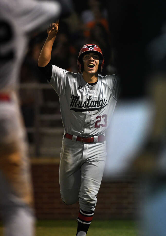 North Shore junior catcher Andrew Lopez scores the go ahead run for the Mustang's in their 6-run top half of the eighth inning against La Porte in game 2 of a best of 3 series in their UIL Class 6A Region III Quarterfinal Baseball Playoff at Pearland Dawson High School on Friday, May 19, 2017. (Photo by Jerry Baker/Freelance) Photo: Jerry Baker/For The Chronicle