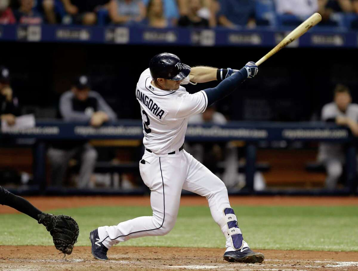 Tampa Bay Rays' Evan Longoria connects for an RBI-single off New York Yankees relief pitcher Tyler Clippard during the eighth inning of a baseball game Friday, May 19, 2017, in St. Petersburg, Fla. Rays' Derek Norris scored. (AP Photo/Chris O'Meara) ORG XMIT: SPD119