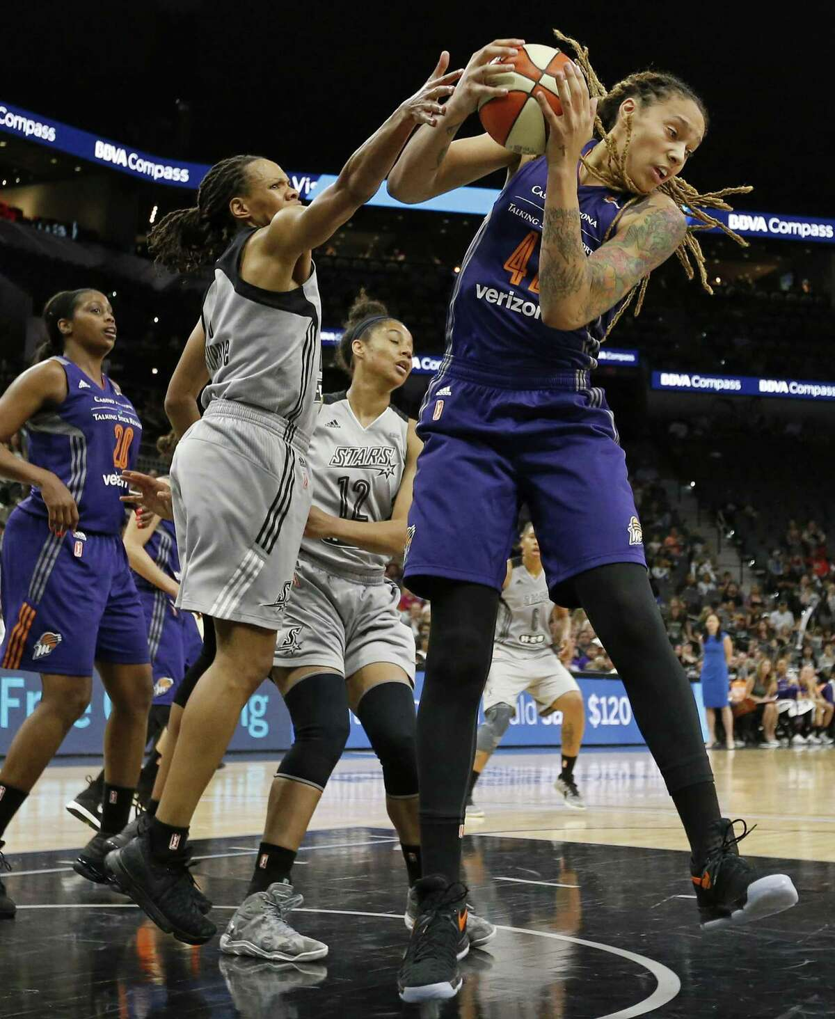San Antonio Stars?• Monique Currie and Phoenix Mercury?•s Brittney Griner grab for a rebound during first half action Friday May 19, 2017 at the AT&T Center.