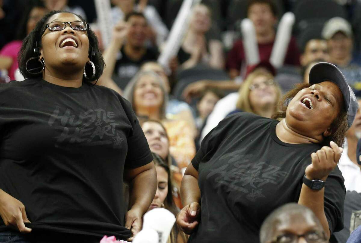 Fans sing during the San Antonio Stars and Phoenix Mercury game Friday May 19, 2017 at the AT&T Center.