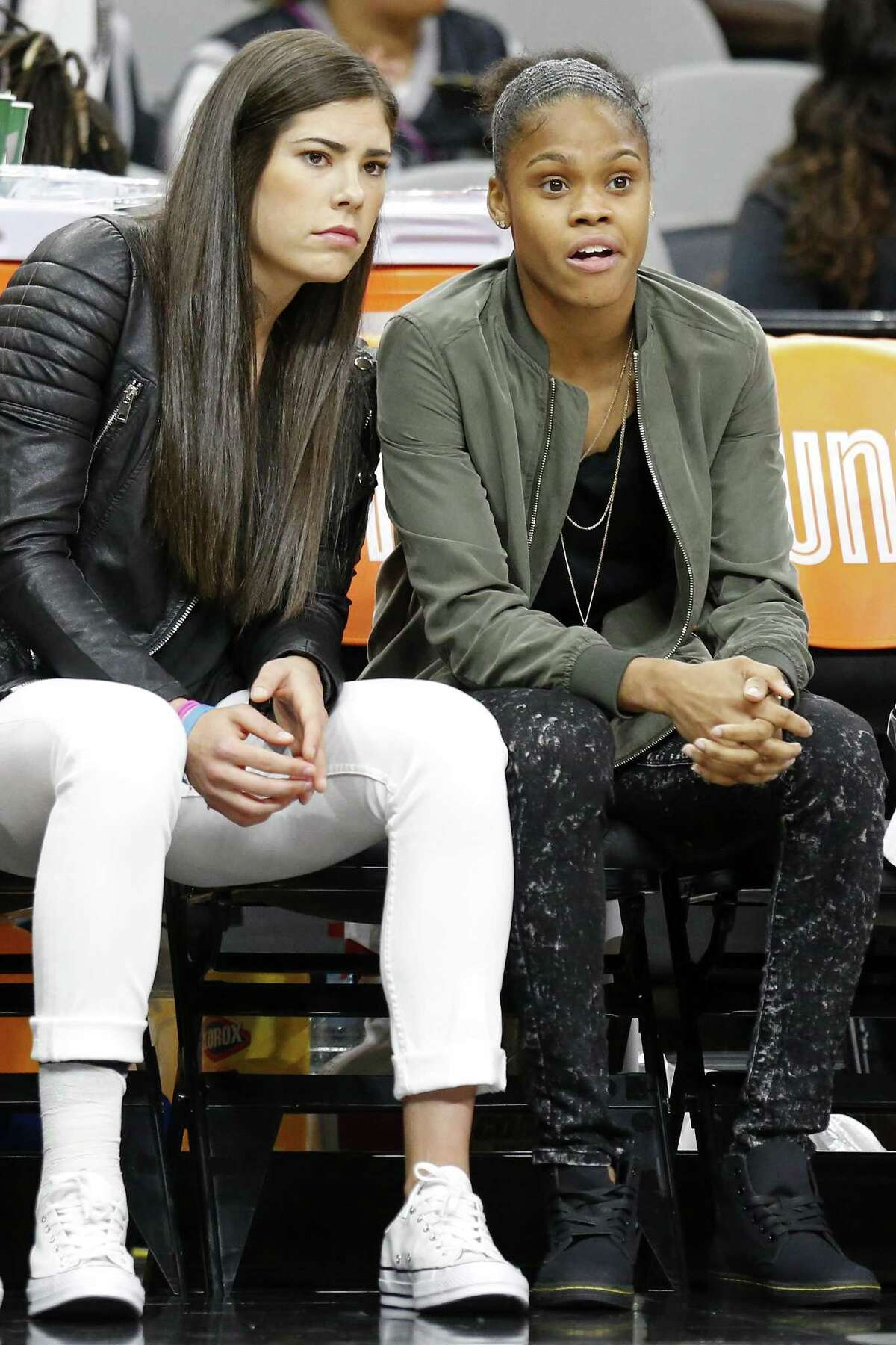 Injured Stars players Kelsey Plum (left) and Moriah Jefferson watch first half action against the Phoenix Mercury from the bench on May 19, 2017 at the AT&T Center.