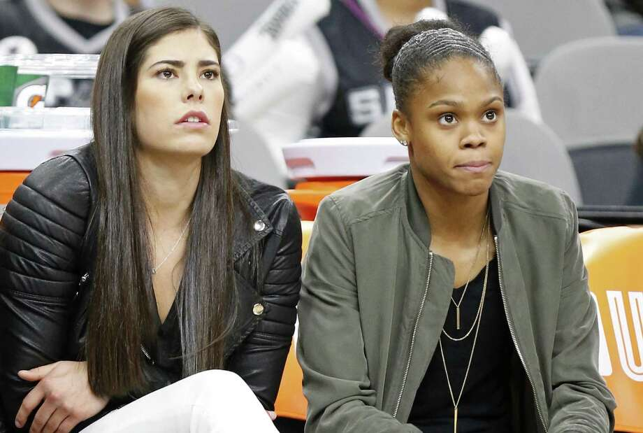 Injured Stars players Kelsey Plum (left) and Moriah Jefferson watch first half action against the Phoenix Mercury from the bench on May 19, 2017 at the AT&T Center. Photo: Edward A. Ornelas /San Antonio Express-News / © 2017 San Antonio Express-News