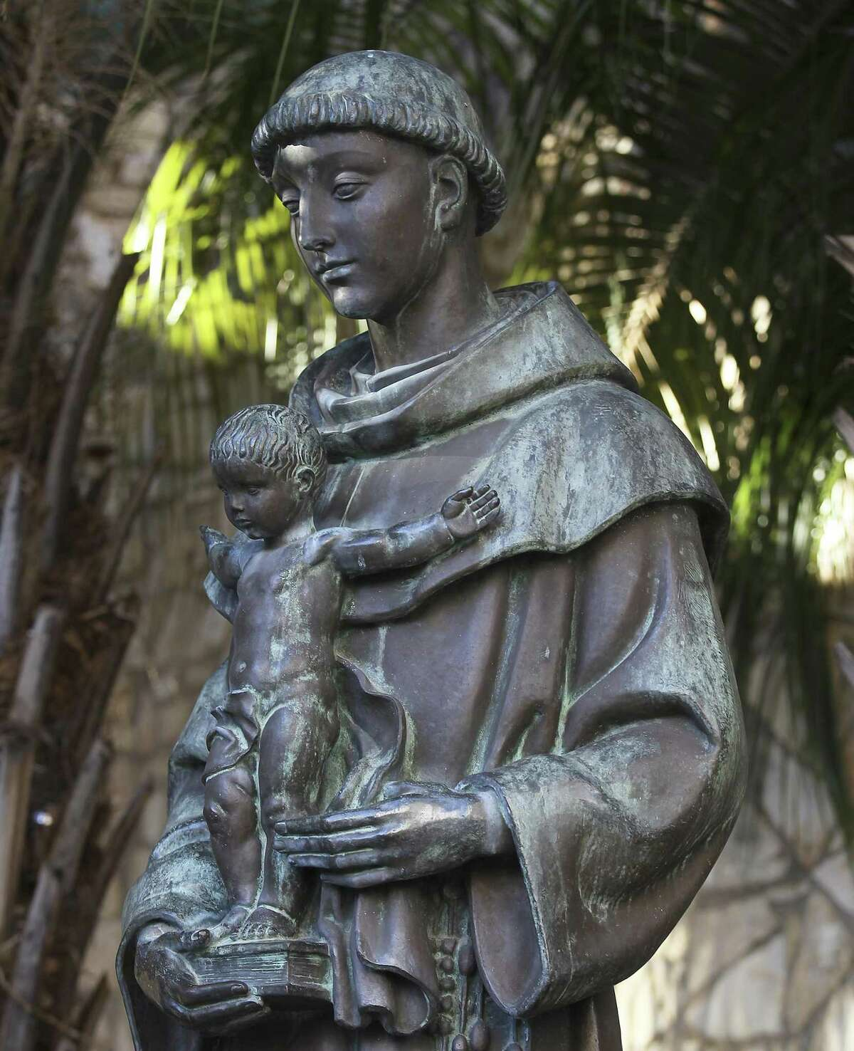 The statue of Saint Anthony of Padua along the River Walk. The seven-foot bronze statue was created by Portuguese sculptor Leopoldo de Almeida and presented to the city during the 1968 HemisFair. (Kin Man Hui/San Antonio Express-News)