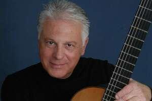 Spanish guitarist Angel Romero performed with the San Antonio Symphony on Friday night.