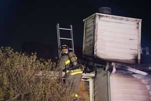 Two people who jumped from a second floor apartment and a police officer who caught a child are recovering after a fire ravaged the apartment in the 8700 block of Cinnamon Creek Drive, Friday, May 19, 2017 on the Northwest Side.