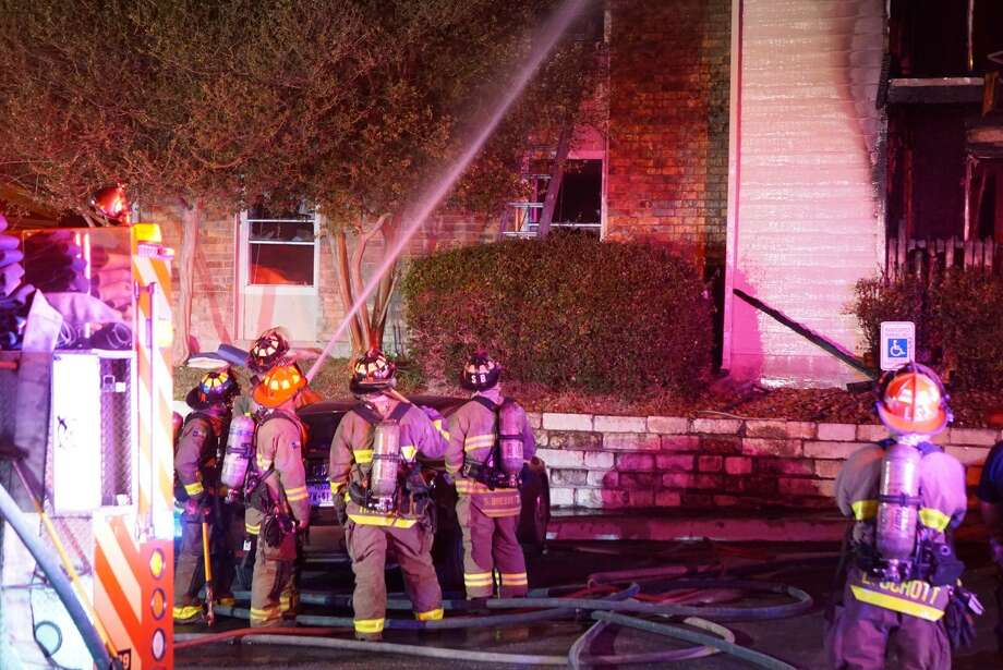 Two people who jumped from a second floor apartment and a police officer who caught a child are recovering after a fire ravaged the apartment in the 8700 block of Cinnamon Creek Drive, Friday, May 19, 2017 on the Northwest Side. Photo: Jacob Beltran