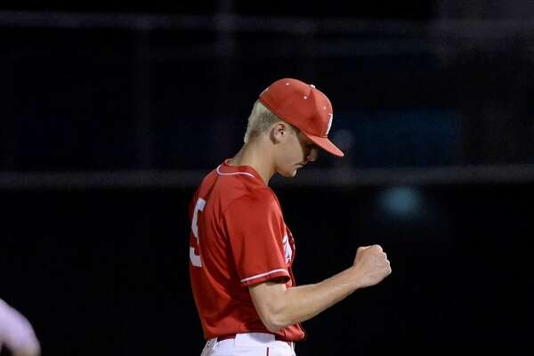 Pitcher Coy Cobb (5) of Katy reacts after the final out in his complete game victory in game 2 of a 6A Region III quarterfinal baseball playoff series between the Katy Tigers and the Travis Tigers on Friday May 19, 2017 at Tompkins HS, Katy, TX.