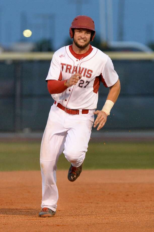 Wes Faison (27) and Fort Bend Travis defeated Katy, 8-2, in the decisive game of their regional quarterfinal series Saturday afternoon. Photo: Craig Moseley/Houston Chronicle