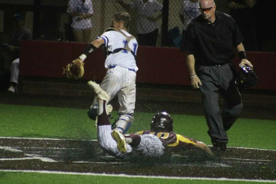 Chase Keng makes a head-first slide across home plate during the four-run uprising in the seventh Friday night. Photo: Robert Avery