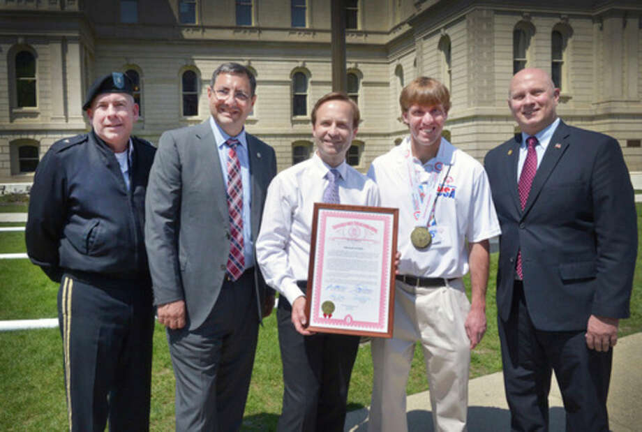 From left, Brig. Gen. Michael A. Stone, assistant adjutant general, Michigan Army National Guard; state Sen. Jim Stamas; Lt. Gov. Brian Calley; Joe Kaczynski; and state Rep. Gary Glenn.