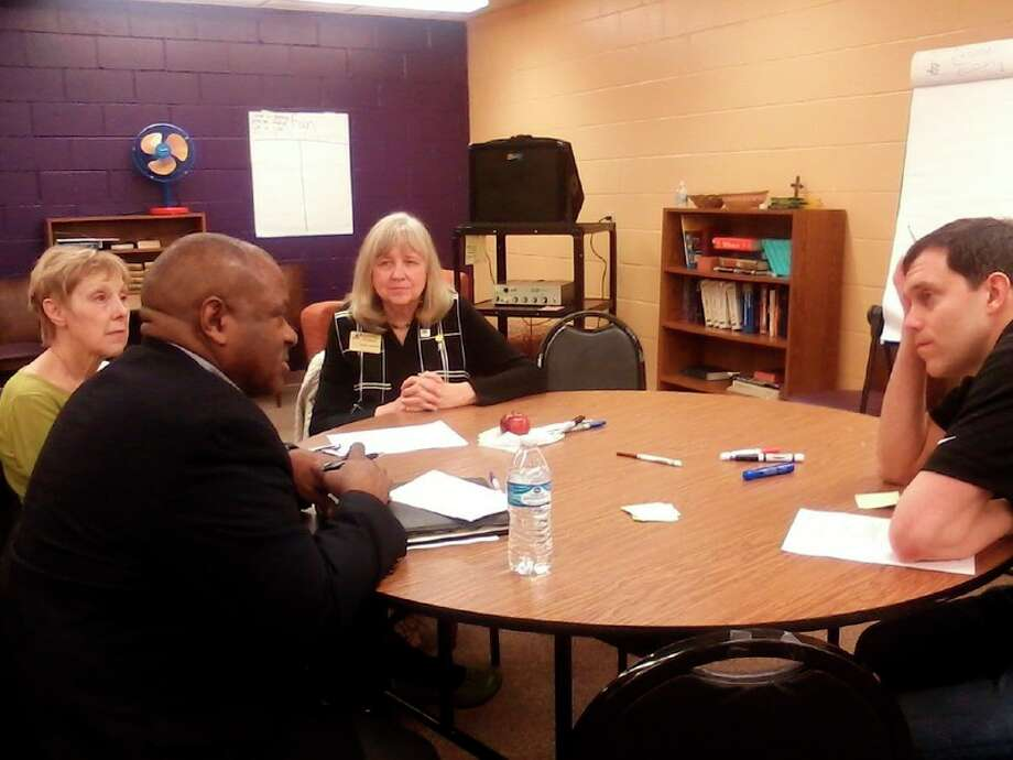 District Governor Cheryl Peterson, Midland Noon Club members Tom Bender and Kevin Kendrick, and Midland Chapter Nonviolent Peaceforce member Randi Kawakita meet during a recent conflict resolution training.