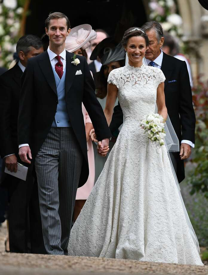 Pippa Middleton and her new husband James Matthews leave church following their wedding ceremony at St Mark's Church as the bridesmaids and pageboys walk ahead on May 20, 2017 in Englefield Green, England. Photo: WPA Pool/Getty Images