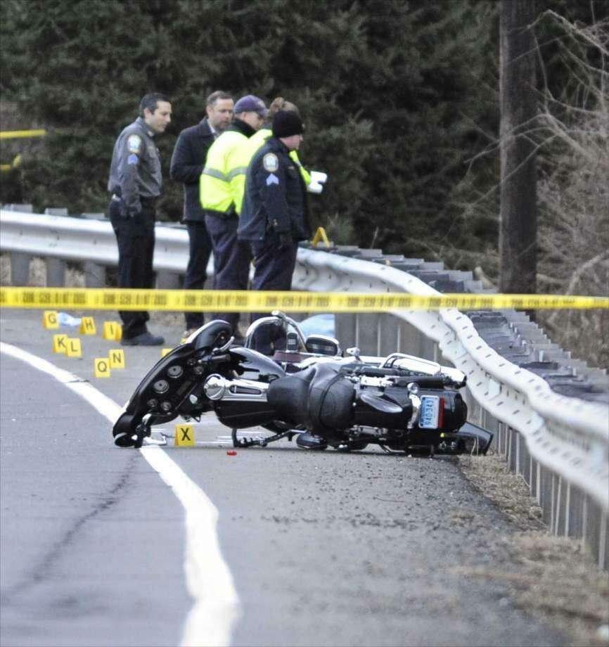Police investigate a motorcycle accident on Mount Pleasant Road near Reservoir Road in Newtown, Conn, on Thursday afternoon, January 19, 2017.
