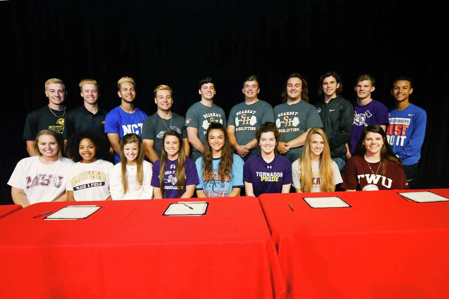 Tomball High School's fifth-annual All-Athletic Collegiate Signing Day featured 20 Cougars signing National Letters of Intent to compete at the next level. Curiously, three of those 20 student-athletes are all headed to Sam Houston State University to compete for the powerlifting squad. Photo: Tony Gaines / HCN