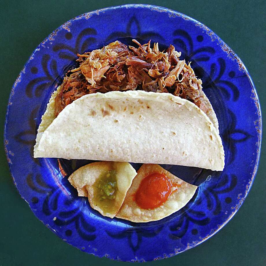 Carnitas taco on a handmade corn tortilla from Las Carnitas Mexican Restaurant. Photo: Mike Sutter /San Antonio Express-News