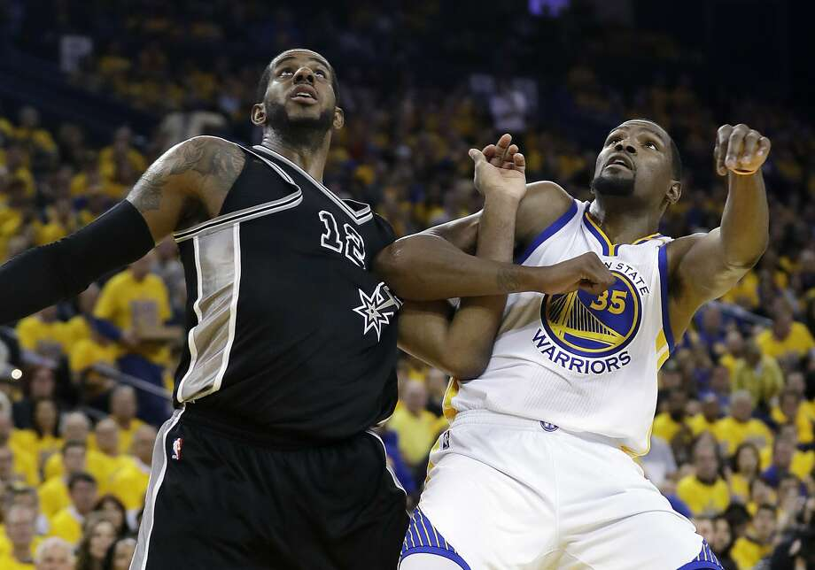 San Antonio Spurs' LaMarcus Aldridge (12) and Golden State Warriors' Kevin Durant (35) work for position under the basket during the second half of Game 2 of the NBA basketball Western Conference finals, Tuesday, May 16, 2017, in Oakland, Calif. (AP Photo/Marcio Jose Sanchez) Photo: Marcio Jose Sanchez, Associated Press