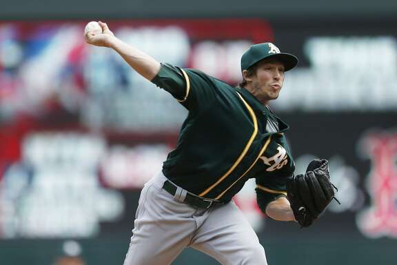 Oakland Athletics pitcher Ryan Dull throws against the Minnesota Twins in the seventh inning of a baseball game Thursday, May 4, 2017, in Minneapolis. (AP Photo/Jim Mone)