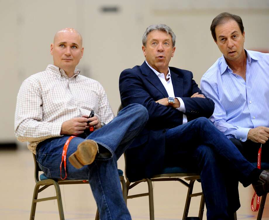 Warriors executives watch a workout session at his team's practice facility on Sunday, June 5, 2011, in Oakland, Calif. From left to right are director of player personnel Travis Schlenk, general manager Larry Riley and team owner Joe Lacob. Photo: Noah Berger / Special To The Chronicle