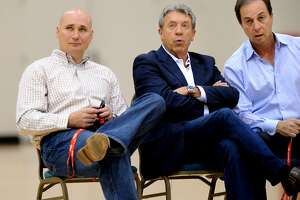 Warriors executives watch a workout session at his team's practice facility on Sunday, June 5, 2011, in Oakland, Calif. From left to right are director of player personnel Travis Schlenk, general manager Larry Riley and team owner Joe Lacob.