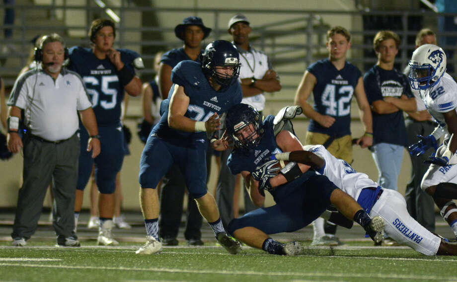 Kingwood junior tight end Matt Bailey, center, finishes a catch against a C.E. King defender during their District 21-6A matchup at Turner Stadium in Humble on Nov. 3, 2016. (Photo by Jerry Baker/Freelance) Photo: Jerry Baker, Freelance / Freelance