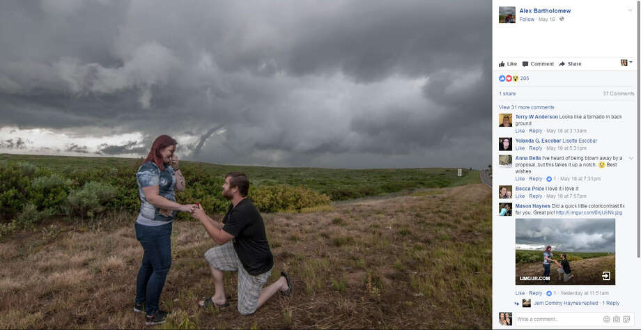 Storm chaser Alex Bartholomew gave his girlfriend Britney Fox Cayton the proposal of a lifetime when he got down on one knee in front of a huge storm — funnel included — in McLean, Texas. Photo: Facebook