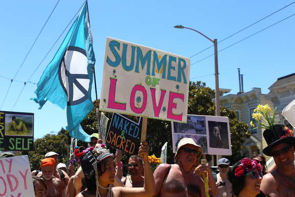 Nudists celebrate the 50th anniversary of the Summer of Love in the Castro on May 20, 2017.
