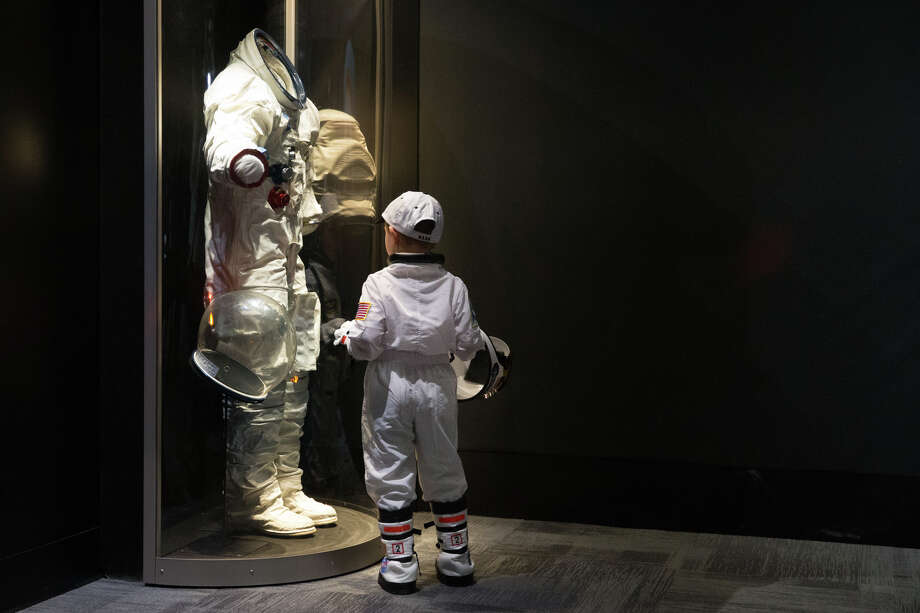 Max Pekarskiy, 4, stands in his space suit as he checks out an Apollo space suit at the opening of the Museum of Flight's new Apollo exhibit in Seattle on Saturday, May 20, 2017. Photo: GRANT HINDSLEY, SEATTLEPI.COM / SEATTLEPI.COM