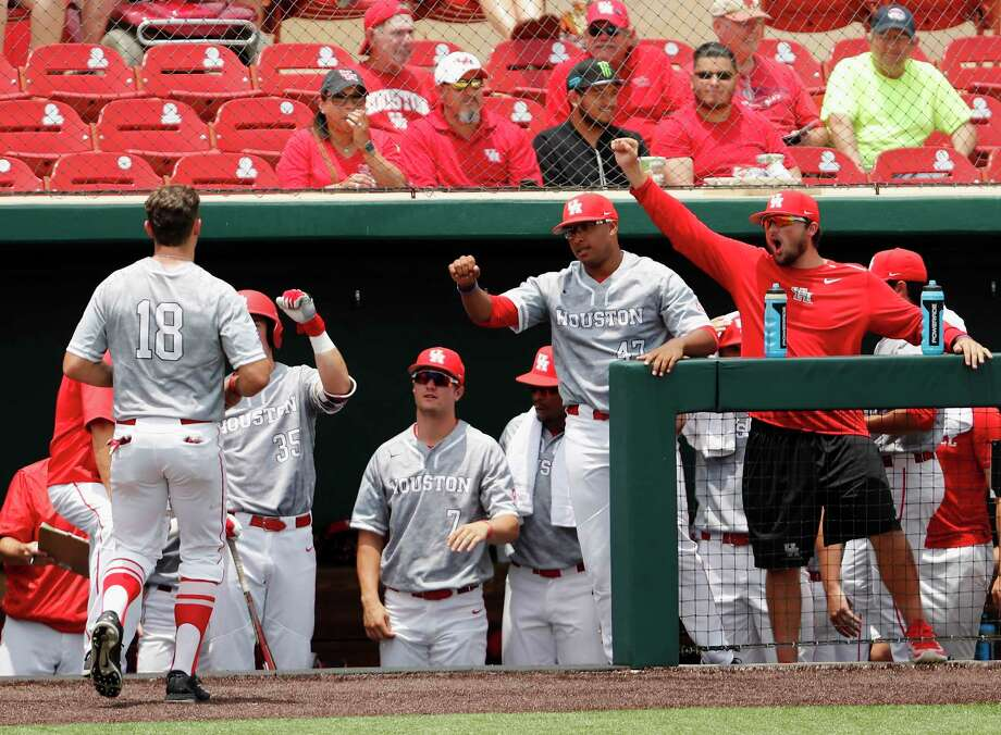 Houston outfielder Grayson Padgett (18) is greeted by teammates after scoring the first run during the NCAA baseball game between the Cincinnati Bearcats and the Houston Cougars at Schroeder Park on Saturday, May 20, 2017, in Houston, TX. Photo: Tim Warner, For The Chronicle / Houston Chronicle