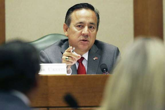 State Sen. Carlos Uresti hears testimony as he sits on the Education Committee at the Texas Capitol on Thursday, a day after being arrested on federal fraud and bribery charges.