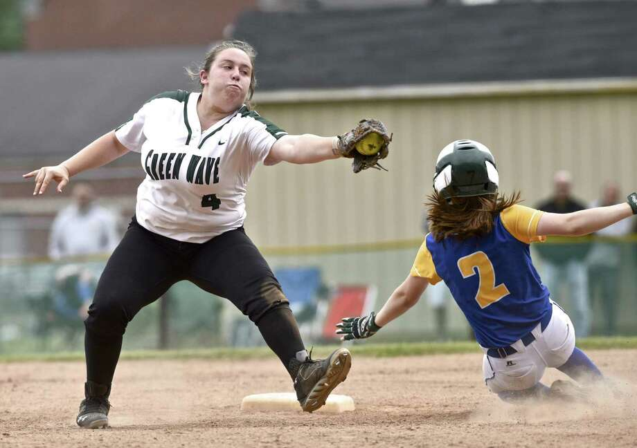 New Milford's Avery Kelly (4) reaches over for the tag as Newtown's Mackenzie Macchiarulo (2) slides safely into second base in the SWC Softball playoff game between Newtown (6) and New Milford (3) on Saturday morning, May 20, 2017, at New Milford High School, in New Milford, Conn. Photo: H John Voorhees III / Hearst Connecticut Media / The News-Times