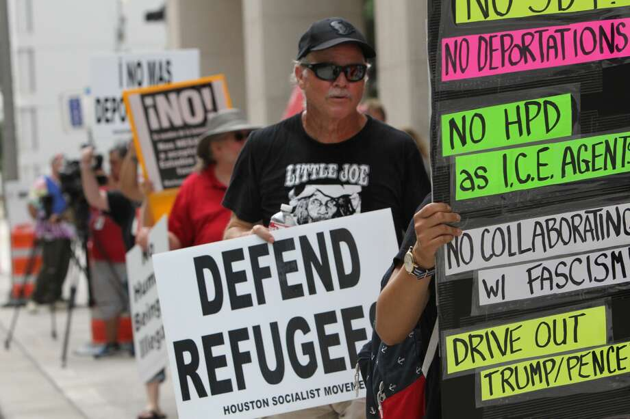 Protestors gathered in front of HPD headquarters voicing concerns over SB4 which will allow police officers to inquire about a person's legal status Saturday May 20, 2017. (Steve Gonzales/Chronicle) Photo: Steve Gonzales/Steve Gonzales / Houston Chronicle