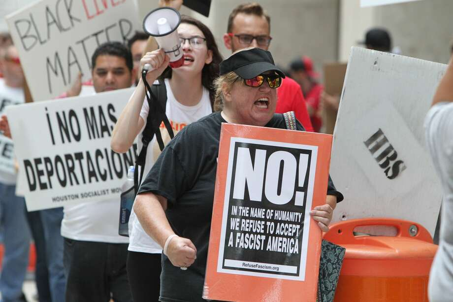 Protesters gathered in front of HPD headquarters on May 20, over SB4 which allows police officers to inquire about a person's legal status. Photo: Steve Gonzales/Steve Gonzales / Houston Chronicle