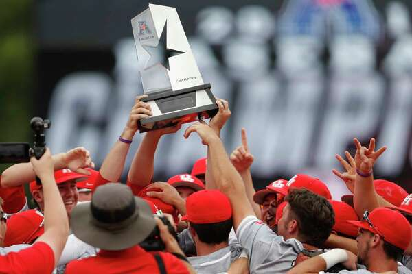 The University of Houston Cougars celebrate with the American Athletic Conference Trophy after the NCAA baseball game between the Cincinnati Bearcats and the Houston Cougars at Schroeder Park on Saturday, May 20, 2017, in Houston, TX.